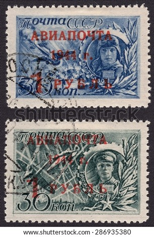 RUSSIA - CIRCA 1944: stamp printed by Russia, shows Heroes of the Soviet Union, fallen in the great Patriotic war - the pilots Talalikhin and Gastello, circa 1944 - stock photo