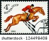 RUSSIA - CIRCA 1982: stamp printed by Russia, shows horse, rider, horseman, speed, fast, quick, rapid, circa 1982 - stock photo