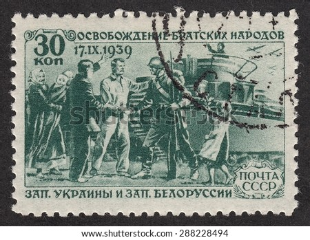 RUSSIA - CIRCA 1940: stamp printed by Russia, shows People meet soldiers of the Soviet army.The liberation of the fraternal peoples of Western Ukraine and Western Belorussia, circa 1940 - stock photo