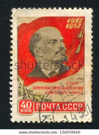 RUSSIA - CIRCA 1957: stamp printed by Russia, shows Red flag, Lenin, circa 1957 - stock photo