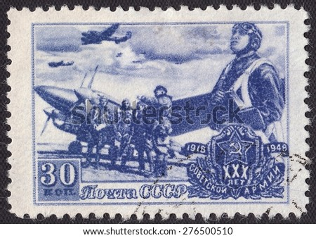 RUSSIA - CIRCA 1948: stamp printed by Russia, shows The pilot of a dive bomber PE-2,30 years of the Soviet Army, circa 1948 - stock photo