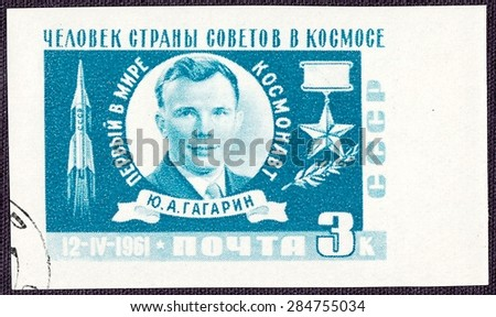 RUSSIA - CIRCA 1961: stamp printed by Russia, shows Yuri Gagarin - the first cosmonaut in the world,people of the country of Soviets in space, circa 1961 - stock photo