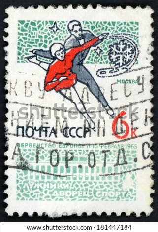 RUSSIA - CIRCA 1965: stamp printed in USSR (CCCP, soviet union) shows man and woman skaters ice dancing and Moscow sports palace, European figure skating championship, Scott 2999 A1497 6k, circa 1965 - stock photo