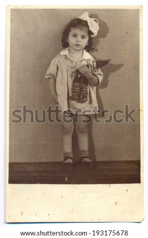 RUSSIA, CIRCA 1940  Vintage photo of little girl with a toy - stock photo
