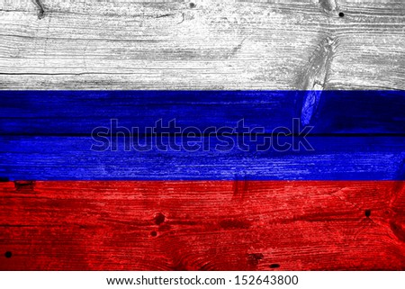 Russia flag painted on old wood plank background - stock photo