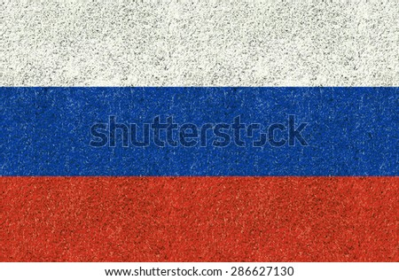 Russia flag texture on green grass in the garden for background - stock photo