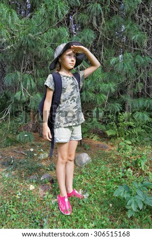 Russia,girl travels through the taiga