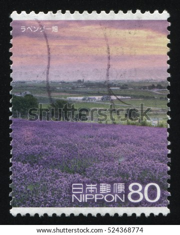 RUSSIA KALININGRAD, 22 APRIL 2016: stamp printed by Japan, shows field of violet flowers, circa 2011