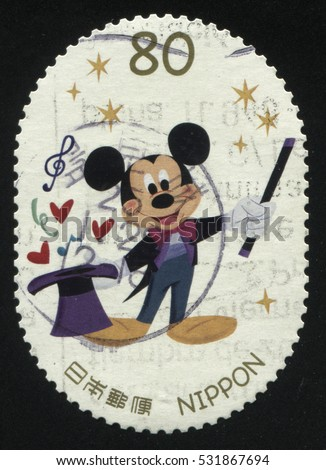 RUSSIA KALININGRAD, 22 APRIL 2016: stamp printed by Japan, shows Mickey Mouse with magic hat, circa 2011
