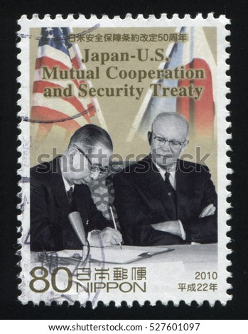 RUSSIA KALININGRAD, 22 APRIL 2016: stamp printed by Japan, shows two statesmen signing security treaty, circa 2010