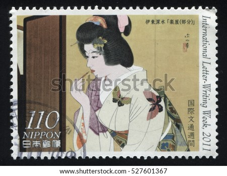 RUSSIA KALININGRAD, 22 APRIL 2016: stamp printed by Japan, shows woman doing her make up, circa 2011