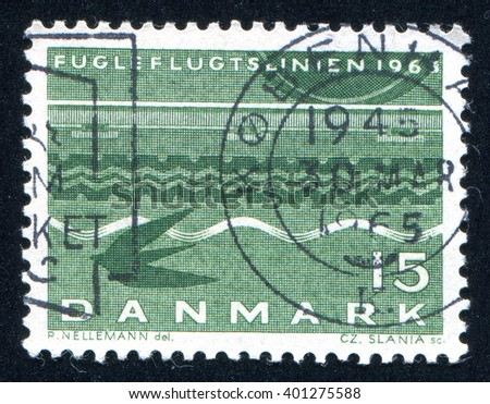 RUSSIA KALININGRAD, 4 JANUARY 2014: stamp printed by Denmark, shows Railroad Wheel, Tire Tracks, Waves and Swallow, circa 1963