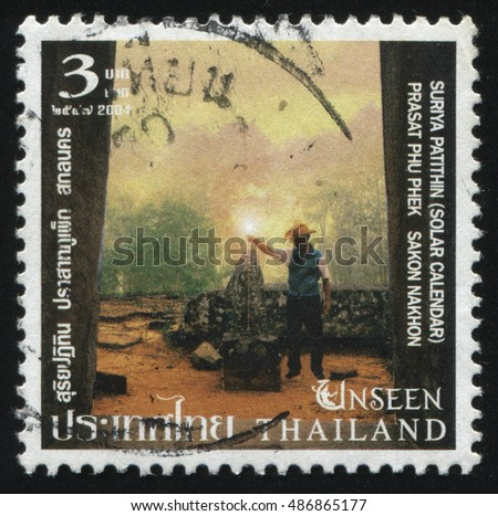 RUSSIA KALININGRAD, 4 JUNE 2016: stamp printed by Thailand, shows a man in the hat near the Solar calendar, Prasat Phu Phek, Sakon Nakhon, circa 2004
