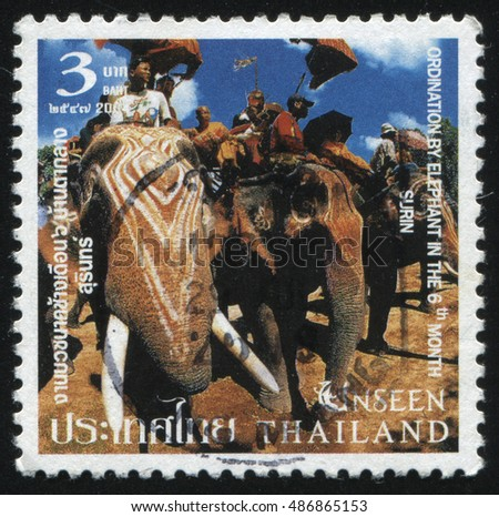 RUSSIA KALININGRAD, 4 JUNE 2016: stamp printed by Thailand, shows asian people on elephants, circa 2004