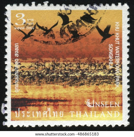 RUSSIA KALININGRAD, 3 JUNE 2016: stamp printed by Thailand, shows birds on water in the sunset, circa 2004