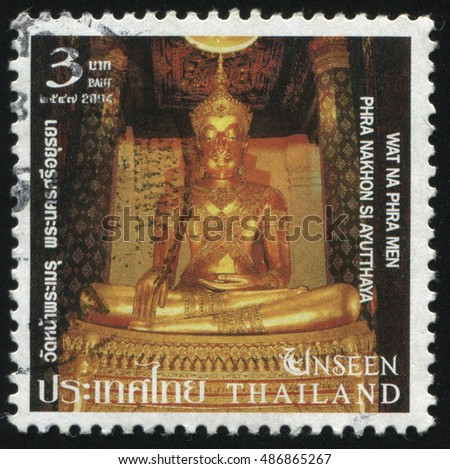 RUSSIA KALININGRAD, 4 JUNE 2016: stamp printed by Thailand, shows golden Buddha's statue on the throne in Wat Na Phra Men temple, circa 2004