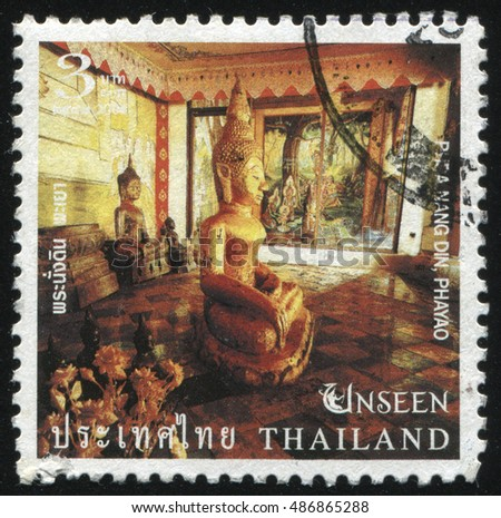 RUSSIA KALININGRAD, 4 JUNE 2016: stamp printed by Thailand, shows golden Buddha statue profile in the Phra Nang Din, Phayao temple, circa 2004