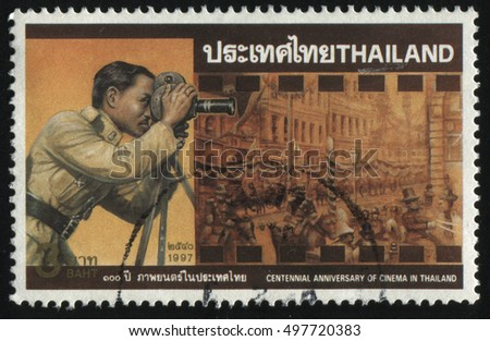 RUSSIA KALININGRAD, 2 JUNE 2016: stamp printed by Thailand, shows King Rama VII filming movie, circa 1997