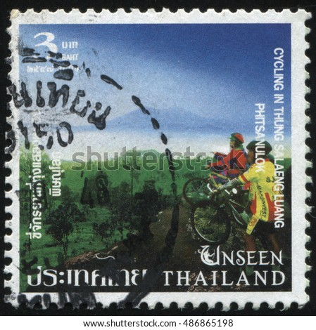 RUSSIA KALININGRAD, 4 JUNE 2016: stamp, printed by Thailand, shows people on bicycles near the forest, circa 2004