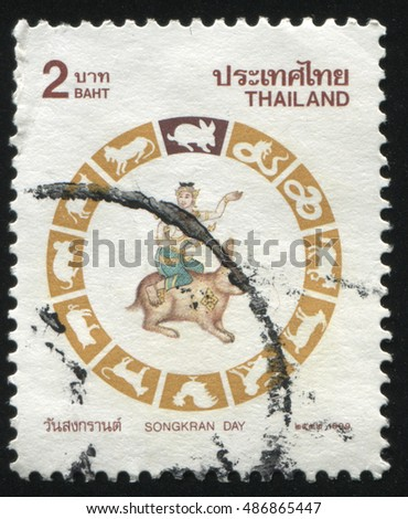 RUSSIA KALININGRAD, 3 JUNE 2016: stamp printed by Thailand, shows person in hat on the rabbit, circa 1999