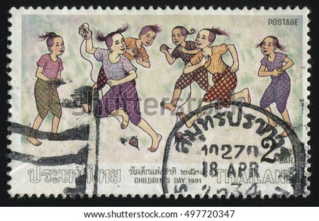 RUSSIA KALININGRAD, 2 JUNE 2016: stamp printed by Thailand, shows playing children, 1991