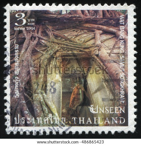 RUSSIA KALININGRAD, 3 JUNE 2016: stamp printed by Thailand, shows temple Wat Bang Kung Samut Songkhram in the trees, circa 2004
