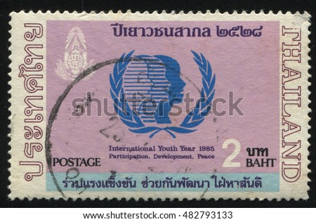 RUSSIA KALININGRAD, 2 JUNE 2016: stamp printed by Thailand, shows three abstract people profiles in the olive branch, circa 1985