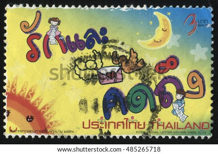 RUSSIA KALININGRAD, 2 JUNE 2016: stamp printed by Thailand, shows two people, reading letters on shine sky background, circa 2013
