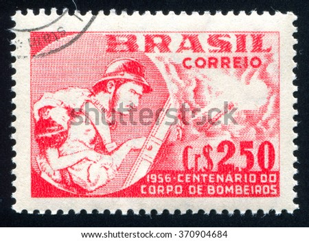 RUSSIA KALININGRAD, 23 MARCH 2014: stamp printed by Brazil, shows  fireman, circa 1956 - stock photo