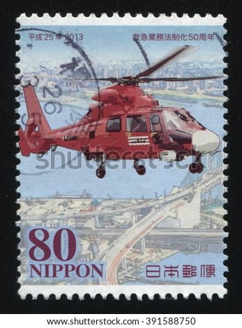 RUSSIA KALININGRAD, 16 MARCH 2016: stamp printed by Japan shows emergency helicopter, circa 2013 - stock photo
