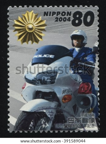RUSSIA KALININGRAD, 16 MARCH 2016: stamp printed by Japan shows Police motorcycle, circa 2004 - stock photo