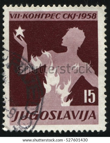 RUSSIA KALININGRAD, 12 NOVEMBER 2016: stamp printed by Yugoslavia, shows a young man on fire, circa 1958