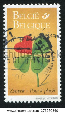 RUSSIA KALININGRAD, 26 OCTOBER 2015: stamp printed by Belgium, shows Four leaf clover with one leaf a heart, circa 1999 - stock photo