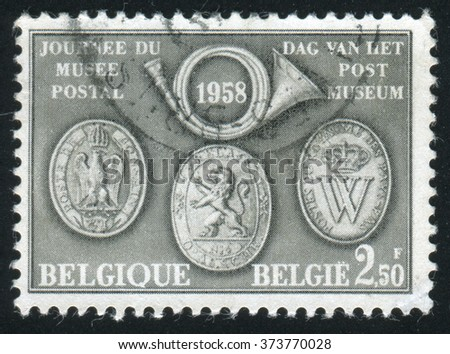RUSSIA KALININGRAD, 26 OCTOBER 2015: stamp printed by Belgium, shows Post Horn and Historic Postal Insignia, circa 1958 - stock photo