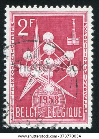 RUSSIA KALININGRAD, 26 OCTOBER 2015: stamp printed by Belgium, shows The Atom and Exposition Emblem, circa 1958 - stock photo