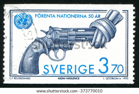 RUSSIA KALININGRAD, 6 OCTOBER 2013: stamp printed by Sweden, shows revolver, circa 1995 - stock photo