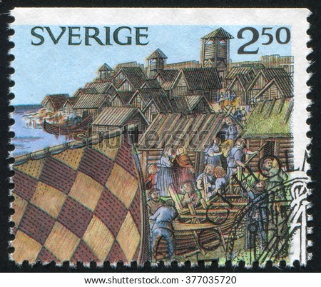 RUSSIA KALININGRAD, 8 SEPTEMBER 2013: stamp printed by Sweden, shows Viking town, circa 1990 - stock photo