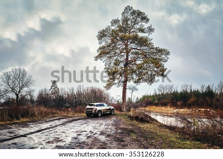 RUSSIA, KAZAN - APRIL 9, 2013: Dirty Range Rover Evoque parked in the off road area by the river, on April 9, 2013 in Russia, Kazan - stock photo