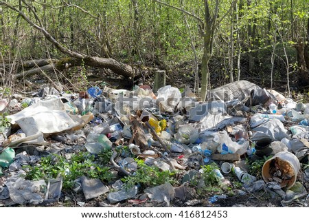 Russia. Kolpino. 7 May. 2016. piles of garbage in the forest. trash heap in woods. trashcan. household waste.  the environmental problem. concept. ecology.