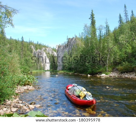 Russia, Komi Republic, summer, taiga. Canoe on the river in the virgin forests of Komi. - stock photo