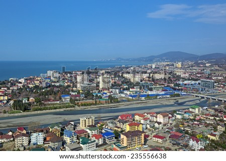 Russia, Krasnodar krai, Sochi cityscape. View from above of a Adler district and river Mzymta - stock photo