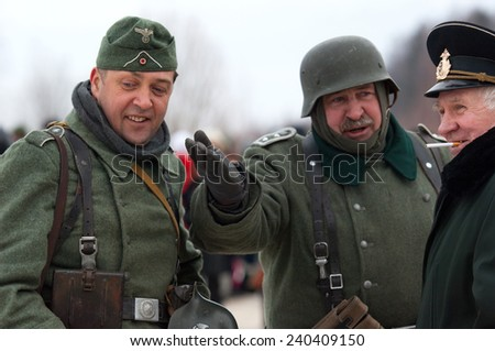 RUSSIA, LIZLOVO - DECEMBER 14: Unidentified German oficers talk on reenactment of the counterattack under the Moscow in 1941 in World War II, in Moscow region, Lizlovo village, Russia, 2014