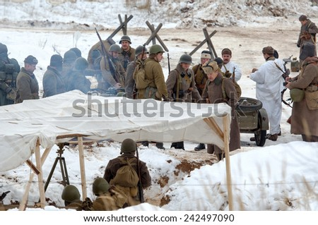 RUSSIA, LIZLOVO - DECEMBER 14: Unidentified russian soldiers gets ready to fight on reenactment of the counterattack under the Moscow in 1941 in World War II, Lizlovo village, Russia, 2014 - stock photo