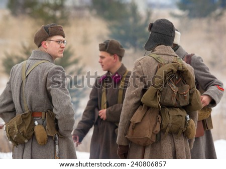 RUSSIA, LIZLOVO - DECEMBER 14: Unidentified soldiers talking and rest just before reenactment of the counterattack under the Moscow in 1941 in World War II, in Lizlovo village, Russia, 2014
