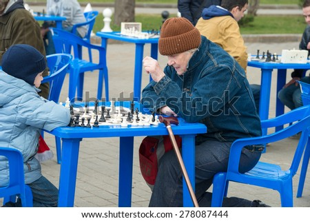 RUSSIA, MOSCOW - APRIL 18:  Several unidentified players play chess  for the celebration on the 80th anniversary of the Spartak sports society in Luzhniki, Moscow, Russia, 2015 - stock photo