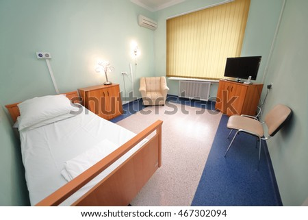 RUSSIA, MOSCOW - AUG 31, 2015: comfortable hospital ward with semi-double bed, television set and conditioner in multidisciplinary Clinic Center Endosurgery and Lithotripsy (CELT)