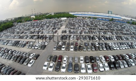 RUSSIA, MOSCOW  JUN 7, 2014: Aerial view lot of vehicles on parking for new car of Avtoframos company at spring sunny day. Photo with noise from action camera