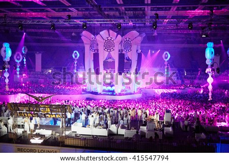 RUSSIA, MOSCOW - JUN 12, 2015: Central stage and dancing people on dance floor around and at grandstands and lounges during Sensation Wicked Wonderland show at Olympiysky sports complex. - stock photo