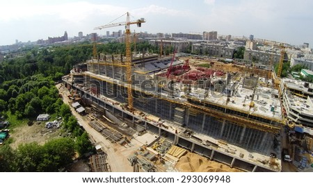 RUSSIA, MOSCOW - JUN 6, 2014: Townscape with construction site of football stadium CSKA at summer sunny day. Photo with noise from action camera - stock photo