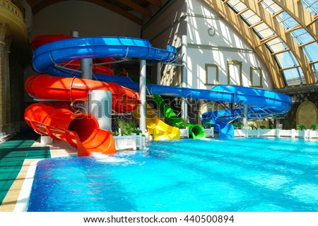 RUSSIA, MOSCOW - JUNE 4, 2016: Multi-colored water slides in a water park